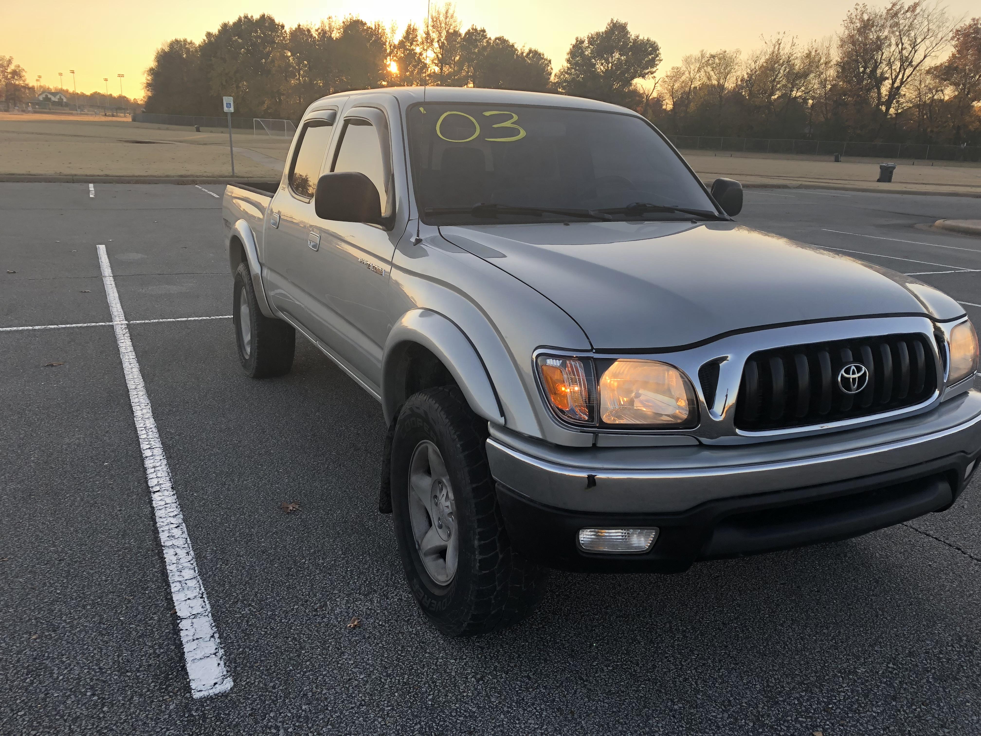 Tan 2003 Toyota Tacoma